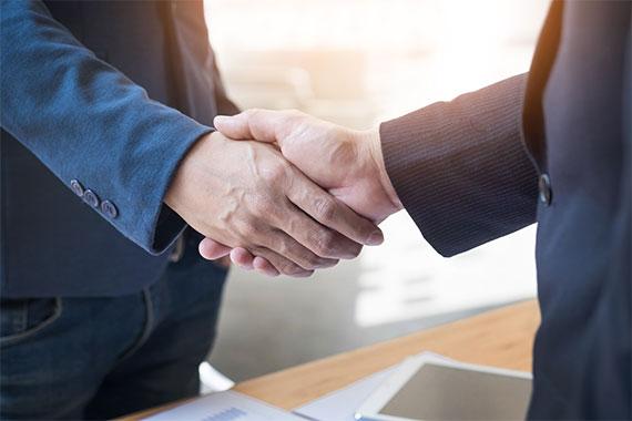 Men shaking hands partnership DS Brands